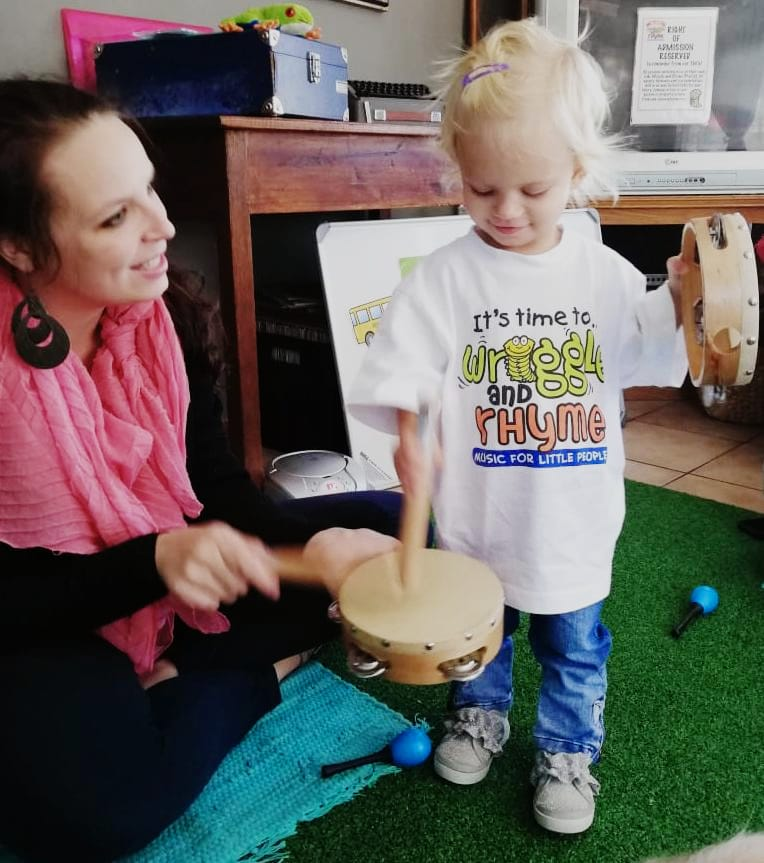 Toddler playing drum in Melkbosstrand