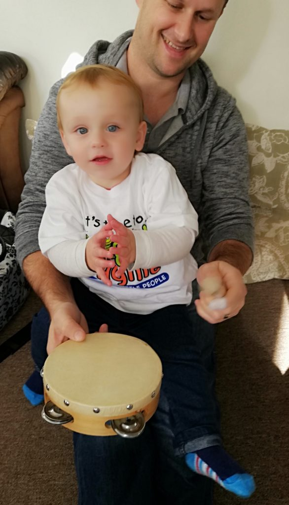 Toddler clapping to music in Fish Hoek