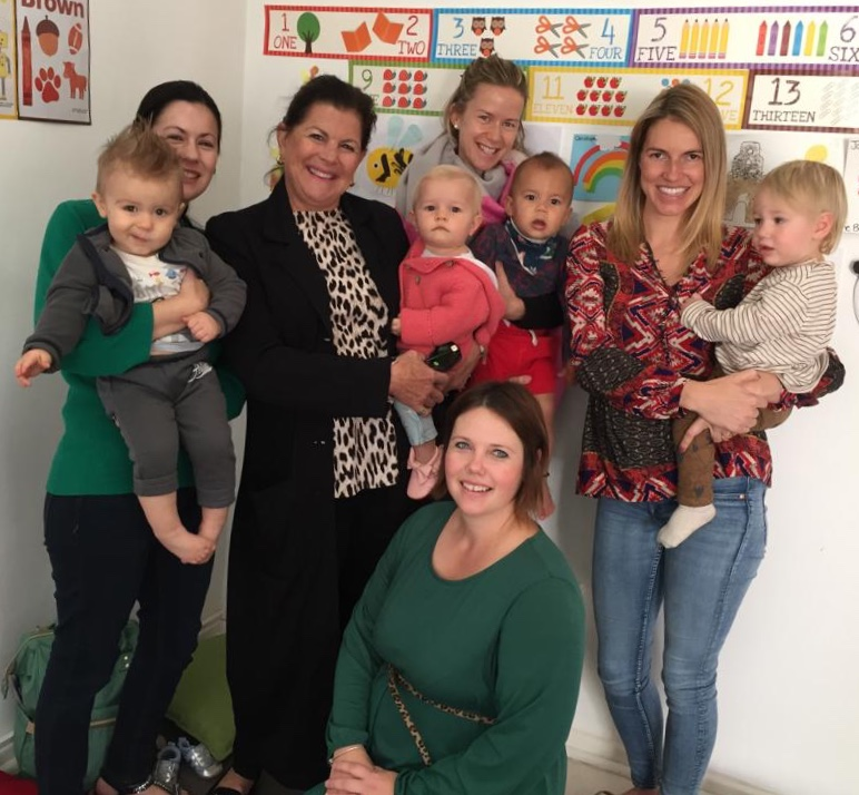 Babies and toddlers and their moms  at music class in Constantia