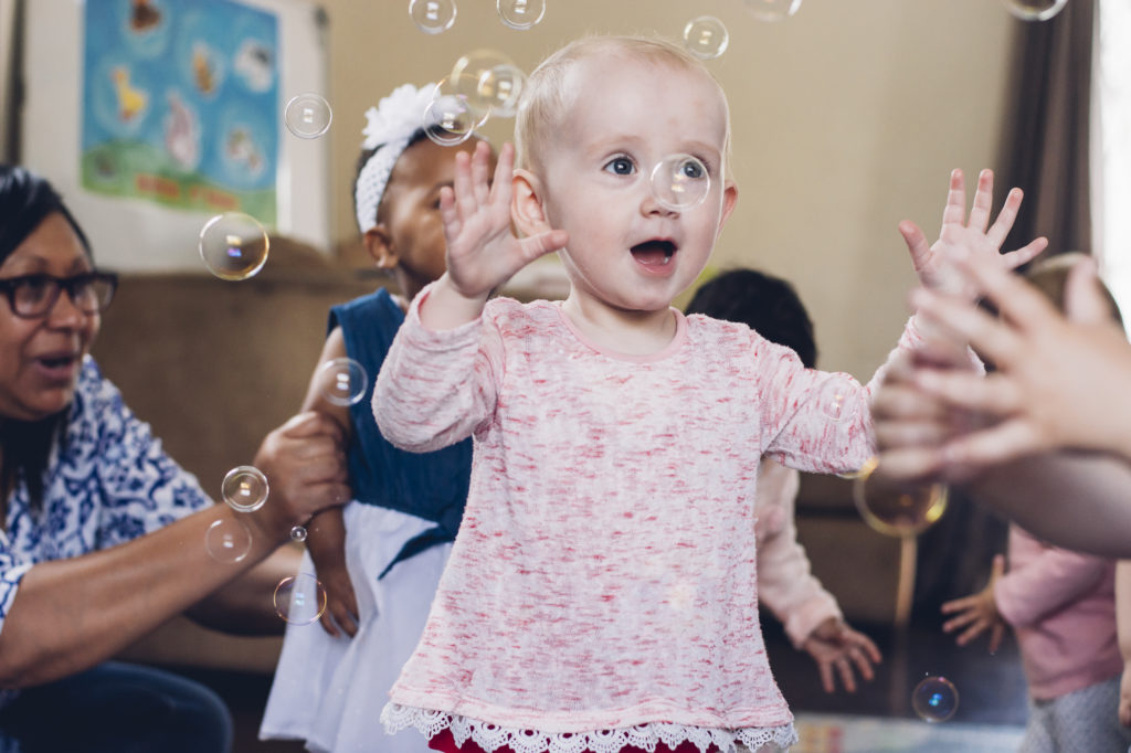 Little girl in bubbles