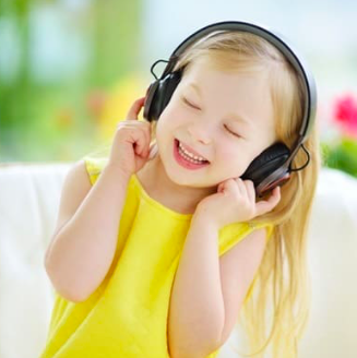 Little girl enjoying music