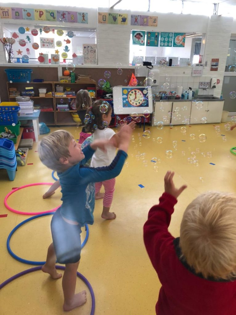 Pre-schoolers playing in bubbles at Wriggle and Rhyme, Cape Town