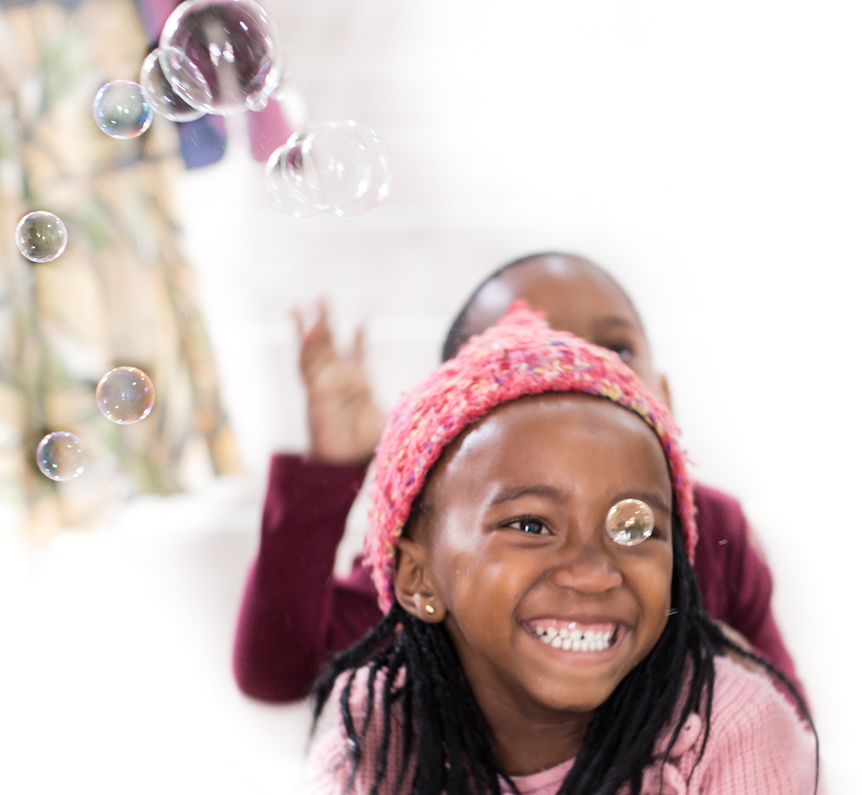 Girl smiling in bubbles